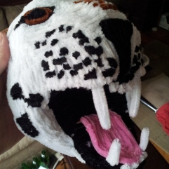 Pipe cleaner leopard head showing the teeth, tongue and spots