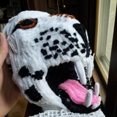 Pipe cleaner leopard head showing the teeth, tongue and spots side view