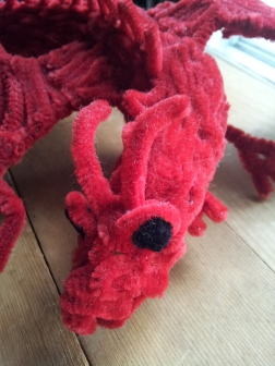 Closeup of the face, eye and horns of the pipe cleaner dragon