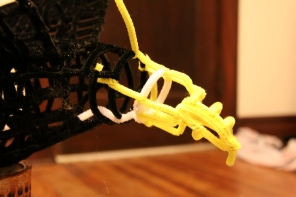 Pipe cleaner eagle frame under construction, showing the beak up close